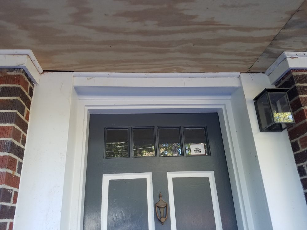 Framing of soffit over door--gaps and 1/4-inch round \