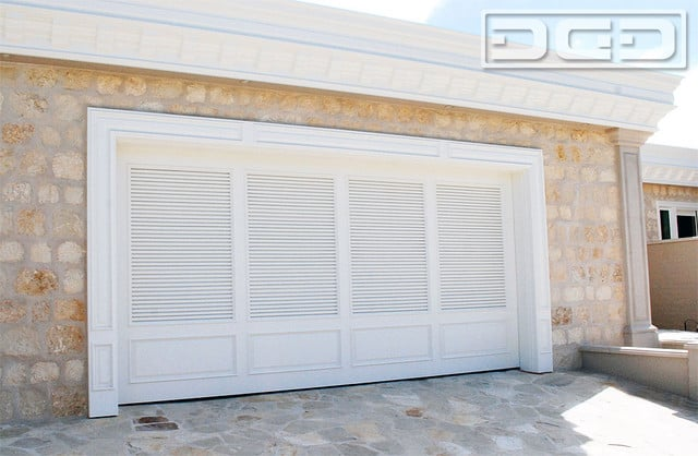 Shutter Style Garage Doors With A Louvered Design And Raised Bottom