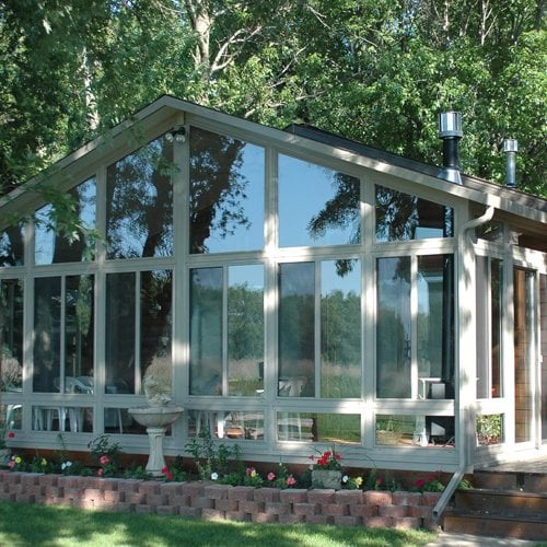Cathedral sun room addition w gable roof and custom glass for Gable roof addition