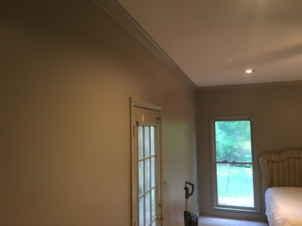 Removed Popcorn on ceiling, Added Crown Mold and Painted the Entire