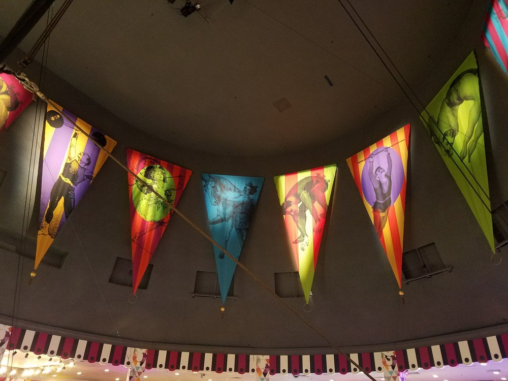 New Festive Flags Adorn The Crown Of The Carnival Tent