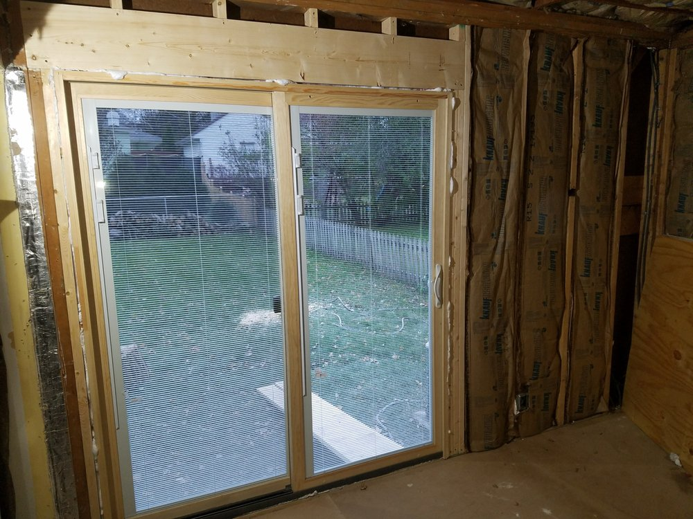 The Brick Was Removed And The Patio Door Was Installed The Spray