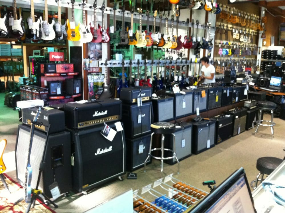some amps and part of the electric guitar selection far and away the largest store in hawaii. Black Bedroom Furniture Sets. Home Design Ideas
