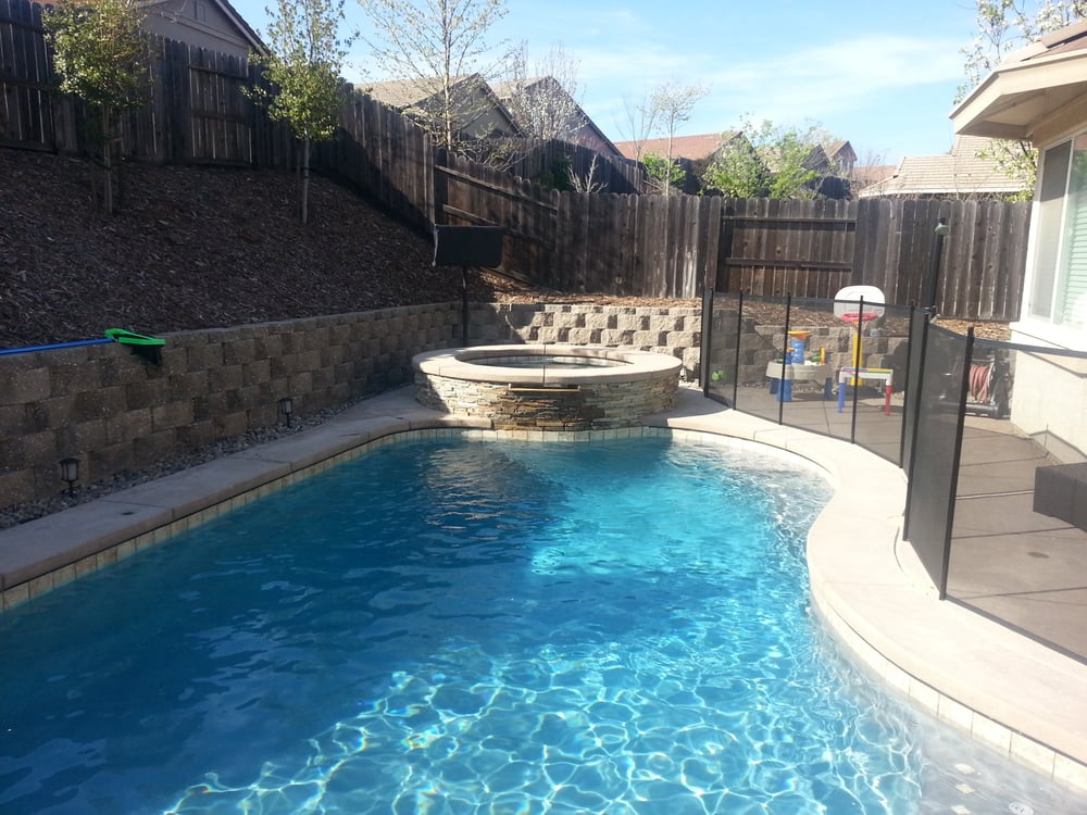 Pool with raised spas spas is wrapped in virginia ledge for Premier pools