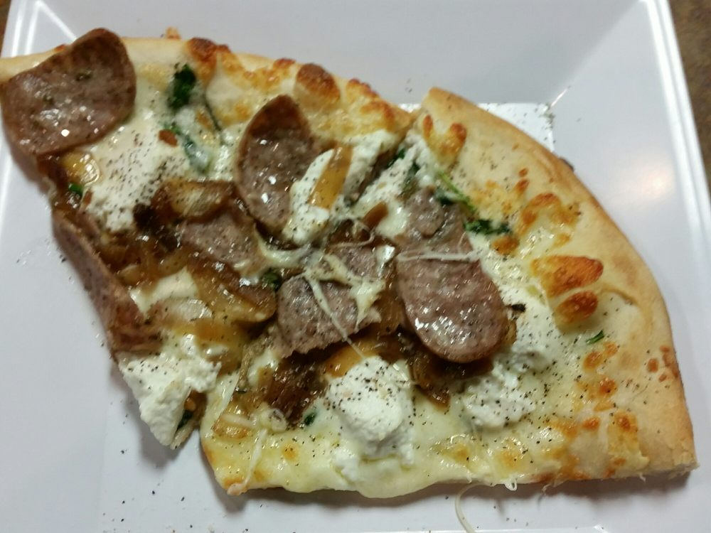 Beautiful New York style white pizza with spinach sauteed onions and ...