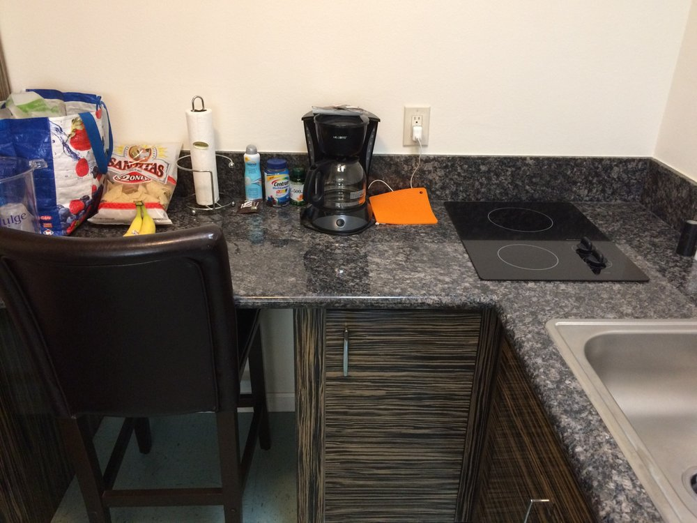 Suite had large kitchen setup with big fridge duh i Small kitchen setup