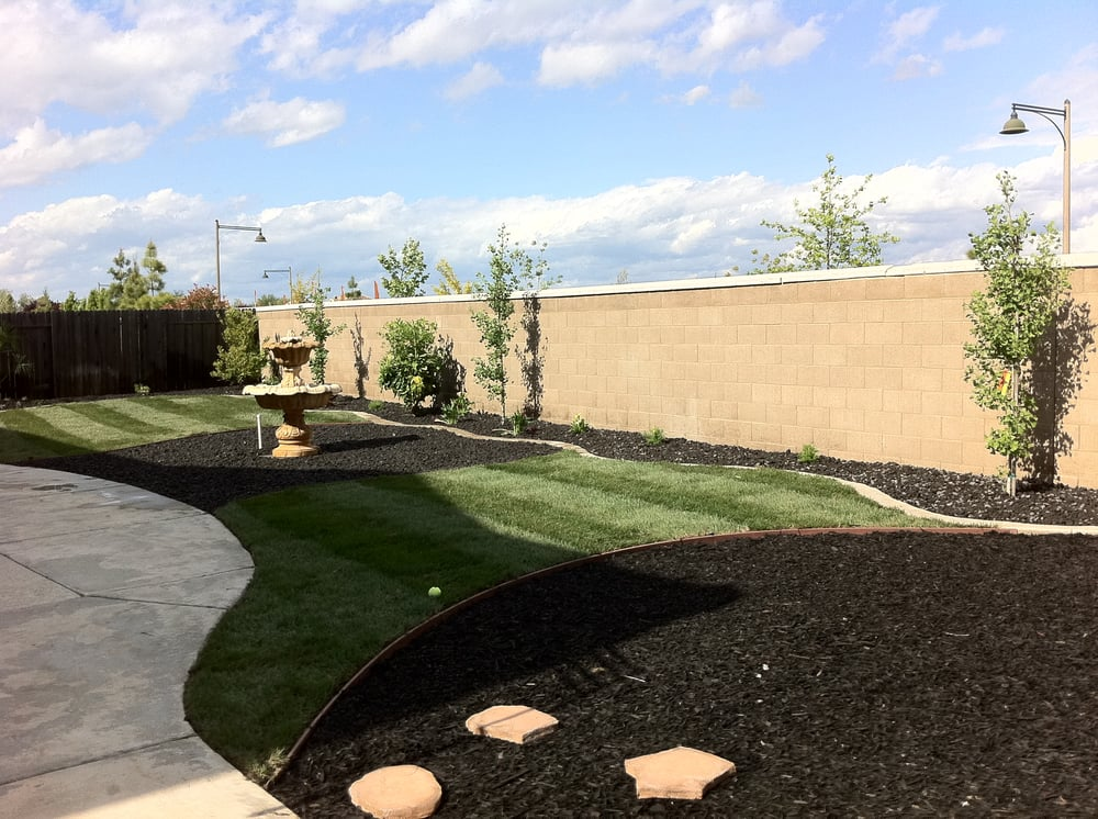 Free form sod areas with lava rock ground cover yelp for Landscaping rocks sacramento