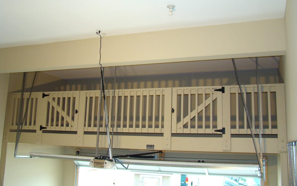 Wooden loft over garage door yelp for Diy garage storage loft