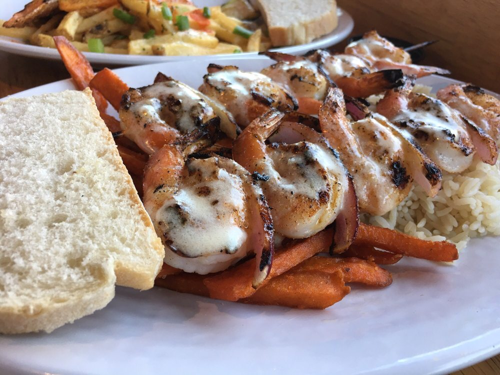 Skewered shrimp with garlic butter sauce and two sides yelp for California fish grill