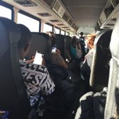 How do you find departure and arrival times for Greyhound buses in NYC?