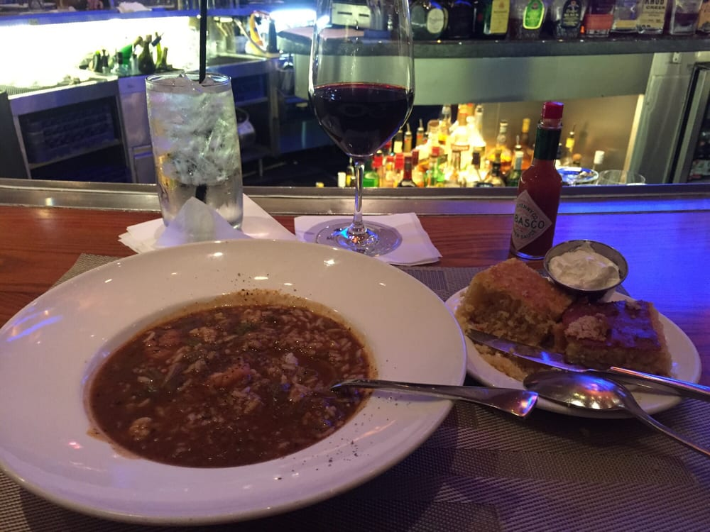 Seafood gumbo with sausage and the bread came out before for New orleans fish house