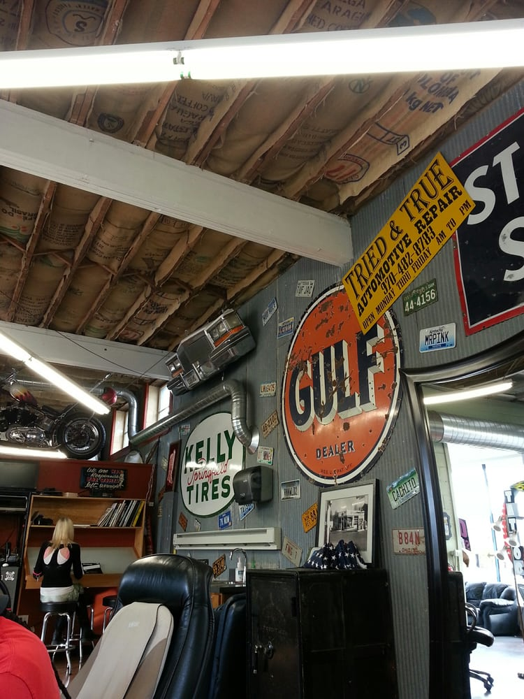 Tattoo shop is located in an old car garage. - Yelp
