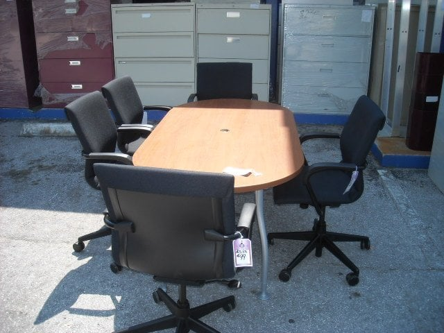 Picture of a used conference table chairs on