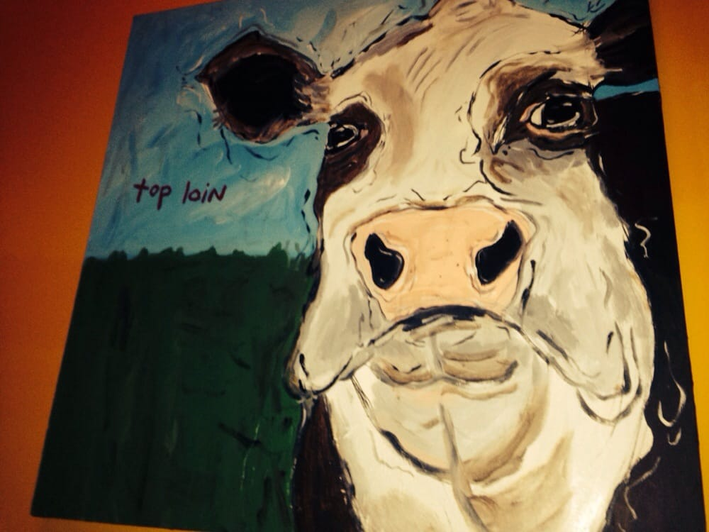 Wall Decor behind my enclosed, private table: disgruntled Cow! - Yelp