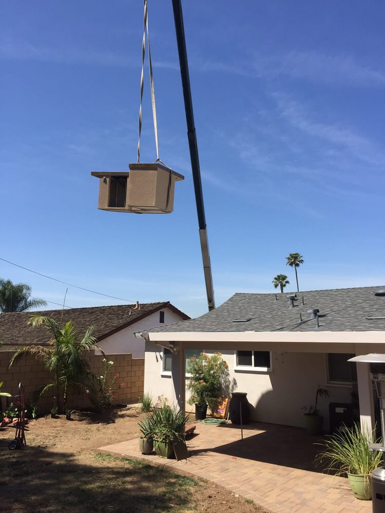Craning it into backyard - Yelp