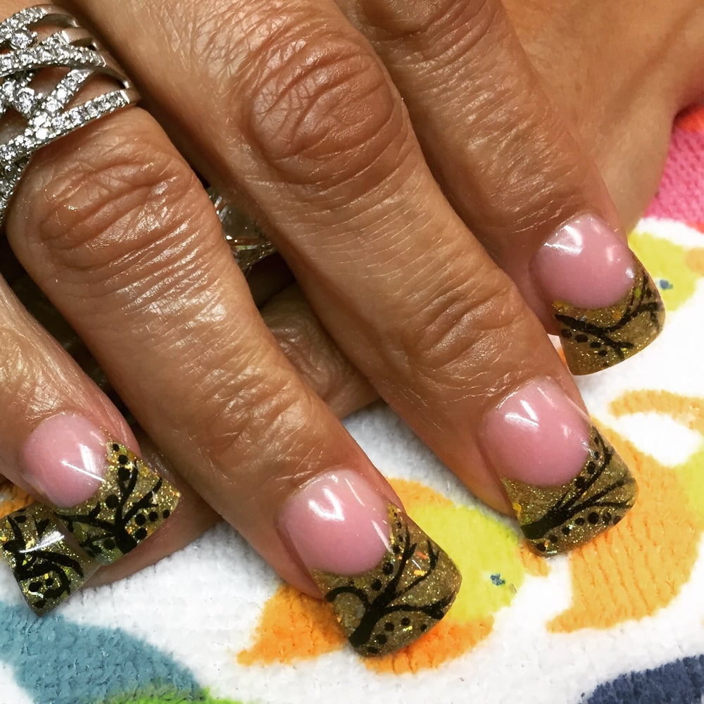 Gold glitter with swirly art nails by sharlene yelp for 50th avenue salon quartz hill ca