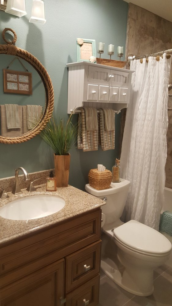The Remodeled Bath Including The Newly Installed Toilet Vanity