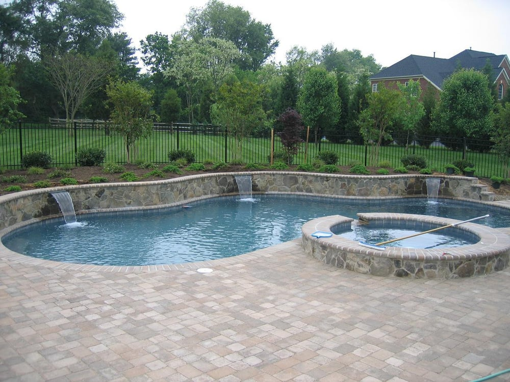 Swimming pool and spa with raised beam and techo bloc pavers in howard county maryland yelp - Swimming pool design ideas and prices ...