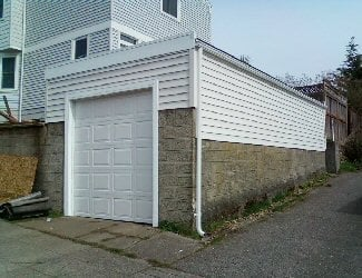 New Garage With Flat Roof Design To Increase Ceiling