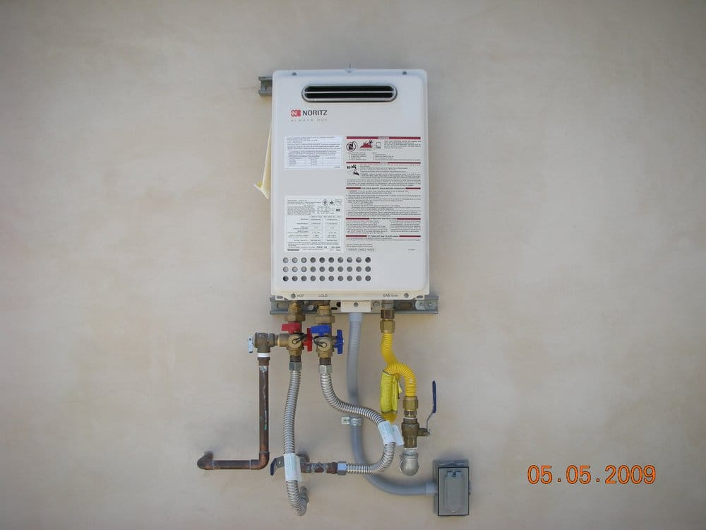 tankless water heater installed on exterior wall - yelp