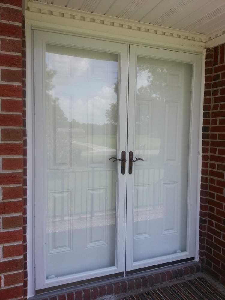 Pella fullview french storm doors with oil rubbed bronze for Storm doors for double entry doors