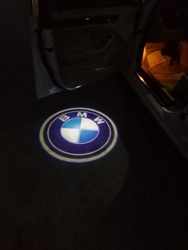 Bmw ghost lights for when you open your car doors the make for Mirror projector review