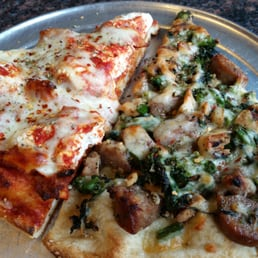 ... Broccoli Rabe and sausage pizza, chicken parm with ricotta deep dish
