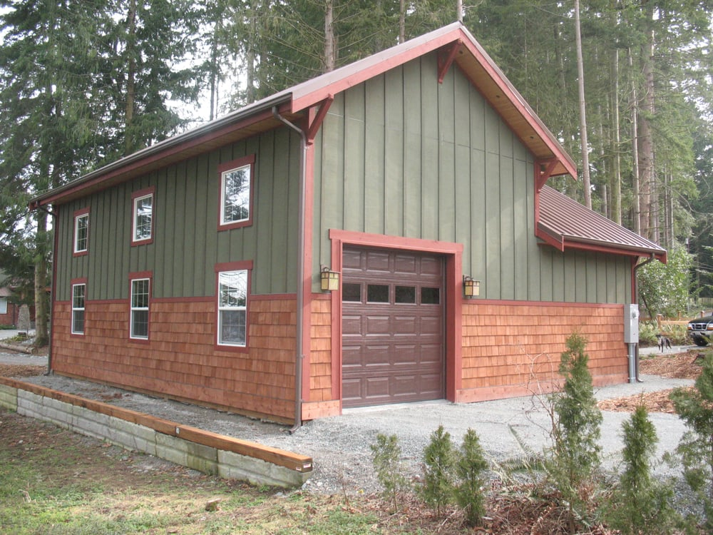 A Post Frame Garage W Cedar Siding And Metal Roof By