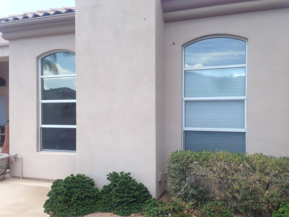 Before photo (approx. 4x8' windows with arch at the top ...