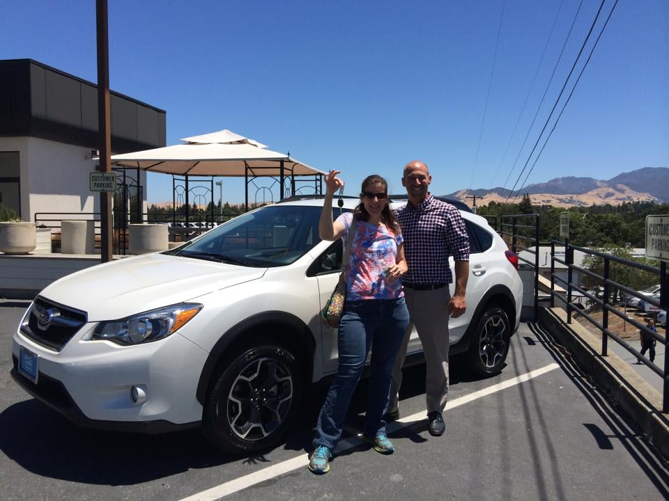 kelly with her new crosstrek and salesman eric yelp. Black Bedroom Furniture Sets. Home Design Ideas