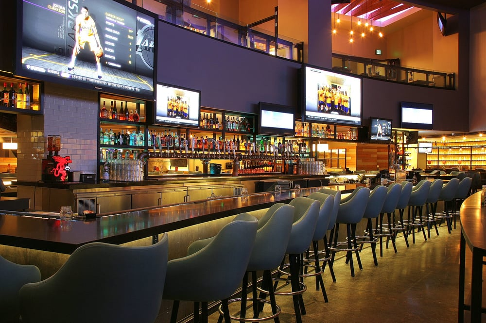 Photo of Tom's Urban - LA Live - Los Angeles, CA, United States. The Sports Deck features 16 big screen tvs as well as high top and booth seating.