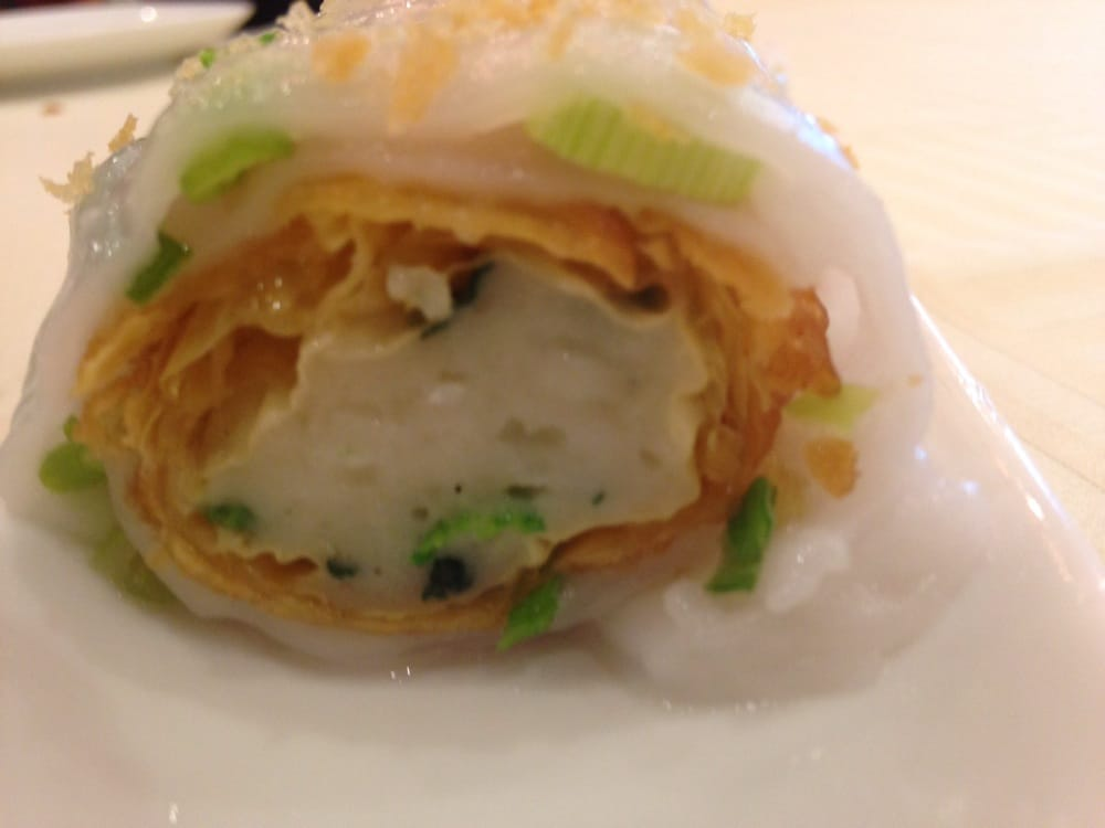 Steamed rice paper with spinach and fish paste.