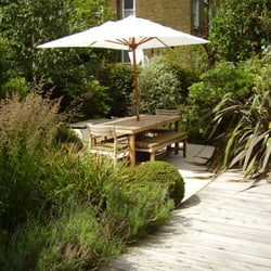 photo of tim mackley garden design london united kingdom seating area surrounded by - Garden Design London