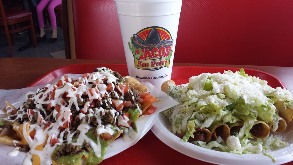 Chicken Taquitos And Carne Asada Nachos With A Refreshing Watermelon Juice Drink Yelp