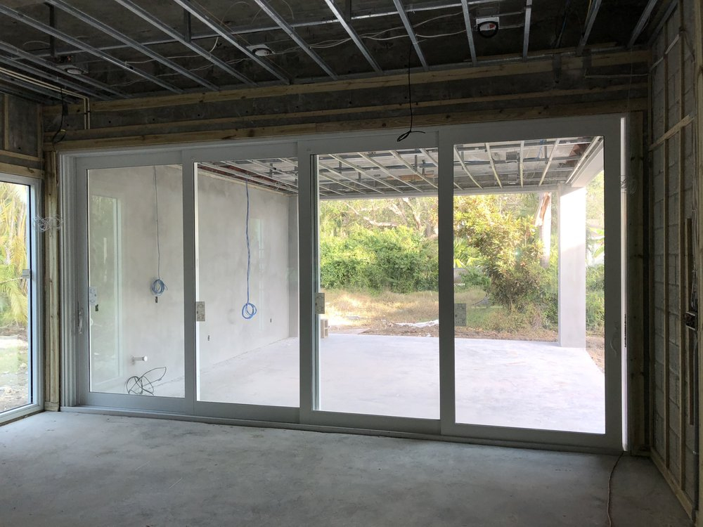 In Progress Installation Of Impact Resistant Sliding Glass Doors