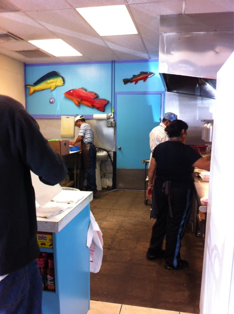 Kitchen and preparation area yelp for Fountainview fish market