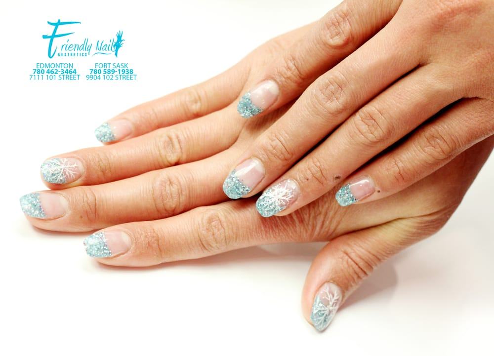 Here\'s another beautiful turquoise blue french tips with snowflake ...
