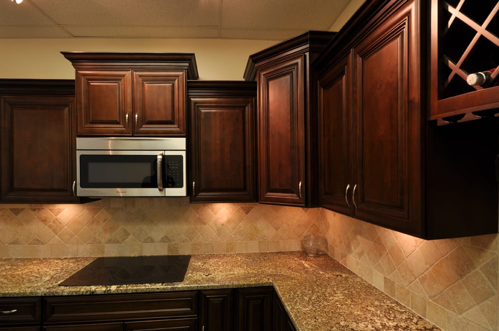 walnut kitchen cabinets showing corner cabinet bump and