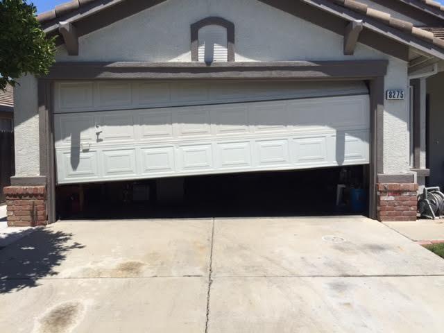 Before Garage Door Stuck Half Way Open Due To Broken