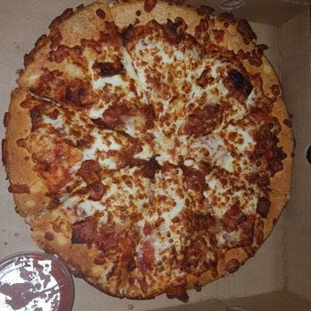 A large, four topping pizza or a family feast with one large, three topping pizza, a medium, one topping pizza, an order of garlic bread with cheese and two dipping sauces.