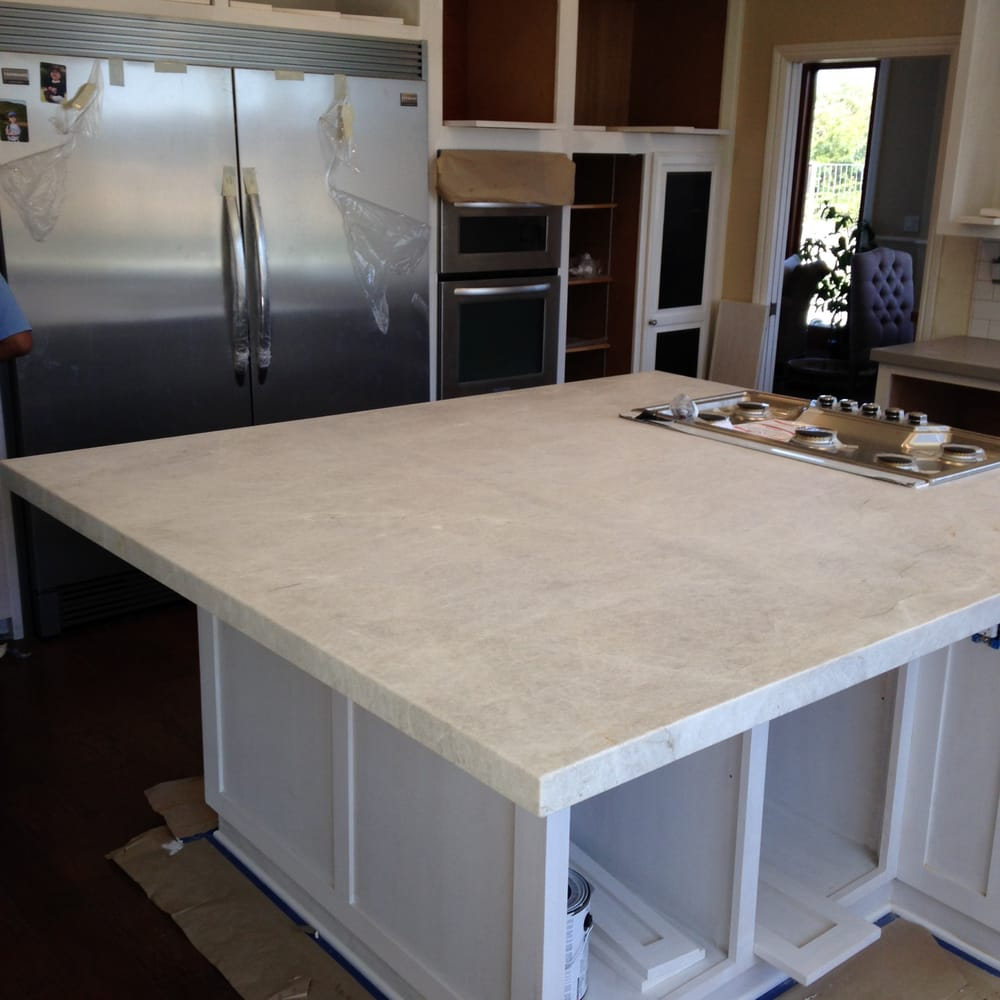 Taj mahal quartzite island with a mitered edge detail yelp for Granite countertop support requirements
