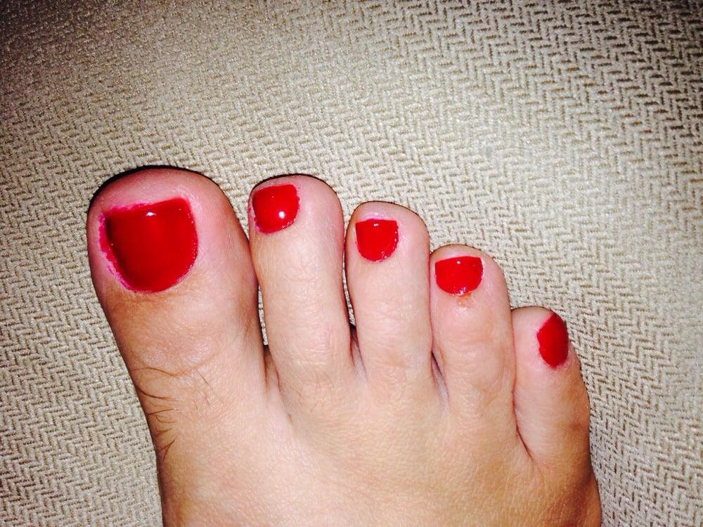 Cut on toe above mail and bad nail polish application. - Yelp