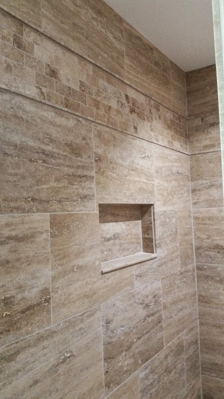Shower Done With 16 X 24 Natural Stone Tiles Accentuated