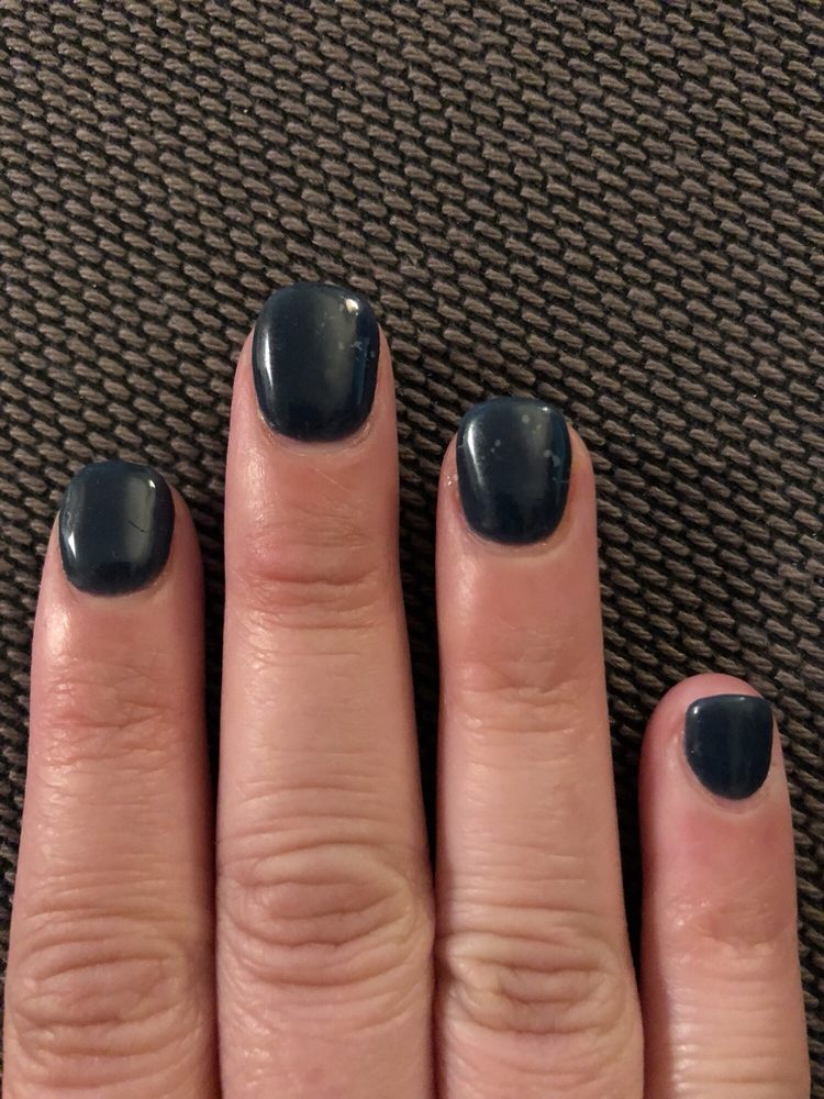 Discolored nails because it looks like the gel top coat wasn\'t ...