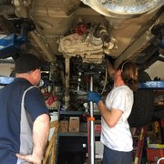 Garage Cats - Northridge, CA, United States. Tim working hard putting my Jeep back together