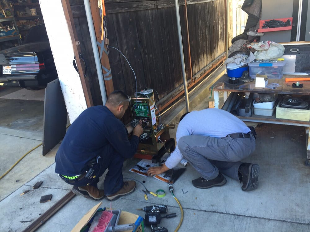 Converting a manuel slide gate to a motorized gate in for Local garage door