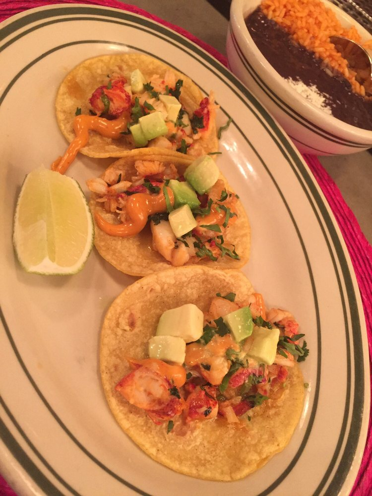 Spicy lobster tacos. Comes with beans and rice. - Yelp