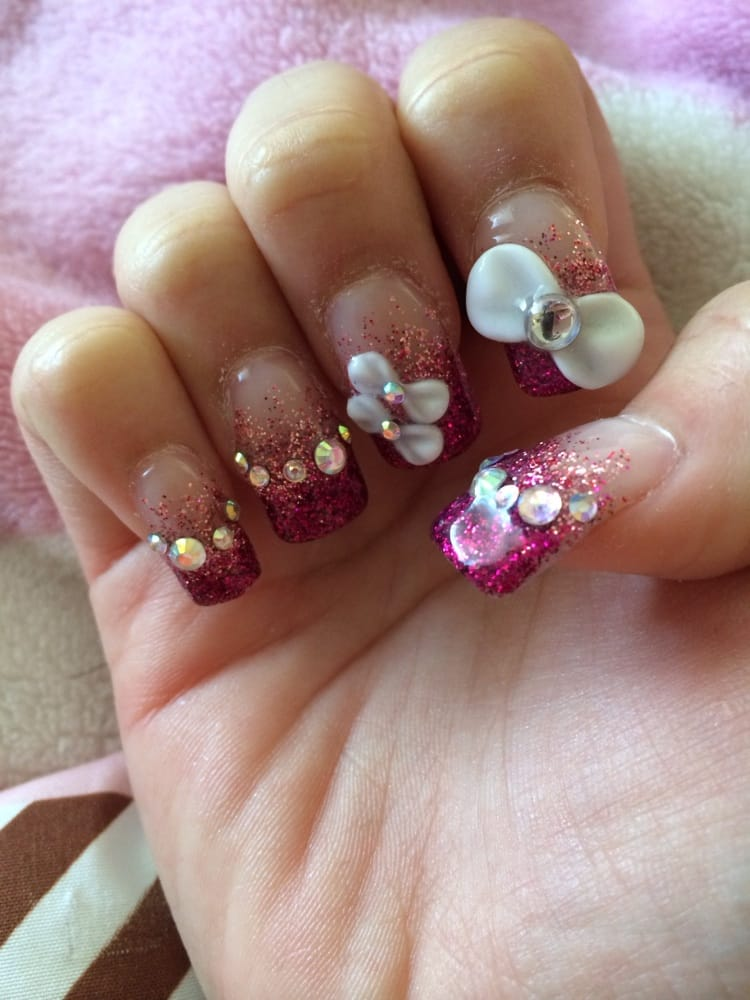 Nail enhancement with handmade 3D bow, stones and glitter gradation ...