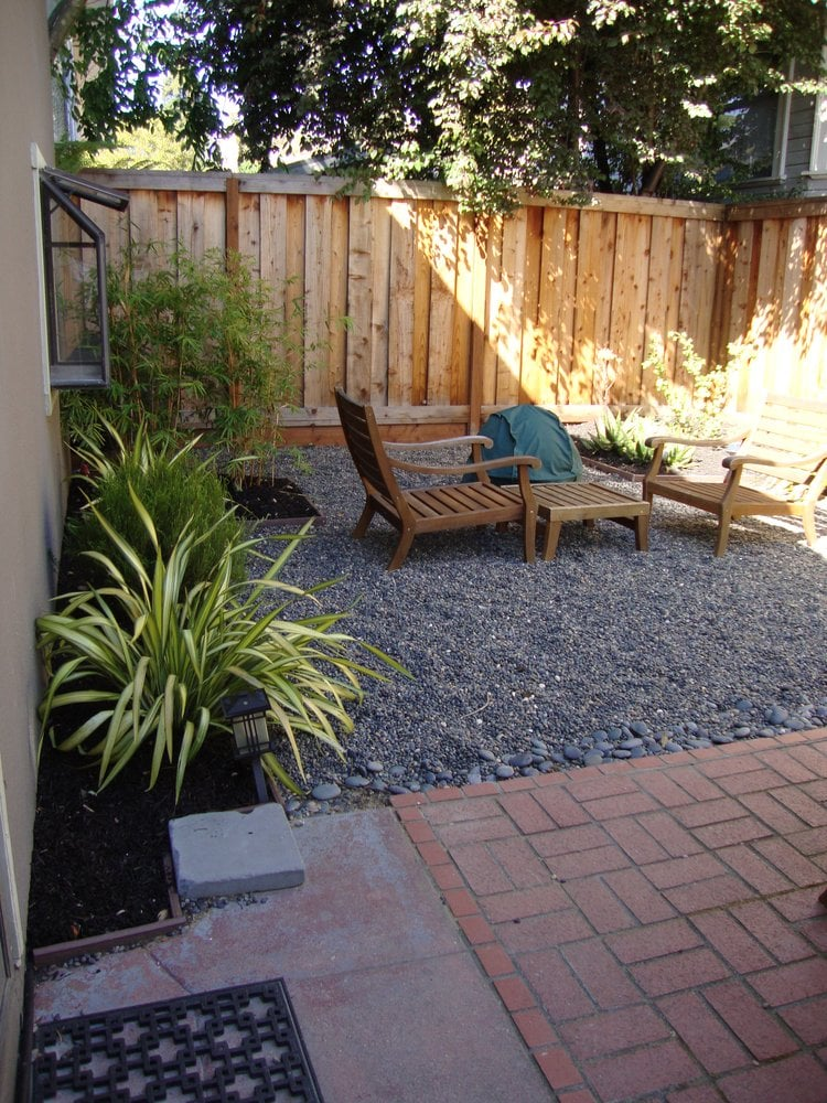 Simple elegance in a low maintenance gravel patio yelp for Low maintenance gravel garden