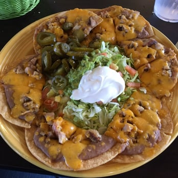 Chicken fajita nachos w/all the fixings! I went during Happy hour and ...